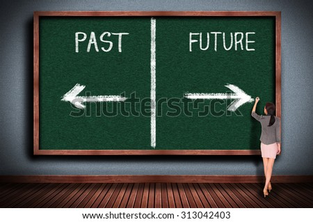Businesswoman drawing future or past on chalkboard - stock photo