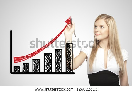 businesswoman drawing growth of chart - stock photo
