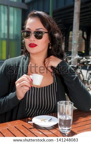 Businesswoman enjoys coffee break in NYC - stock photo
