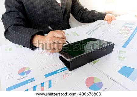Businesswoman examine finance, tax, accounting, statistics and analytic research concept - stock photo