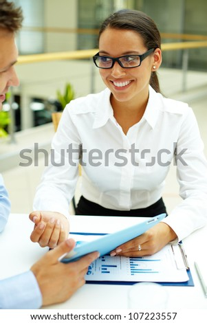 Businesswoman explaining her ideas or solutions to companion - stock photo