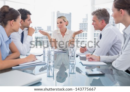 Businesswoman gesturing as she ignores something during a meeting - stock photo