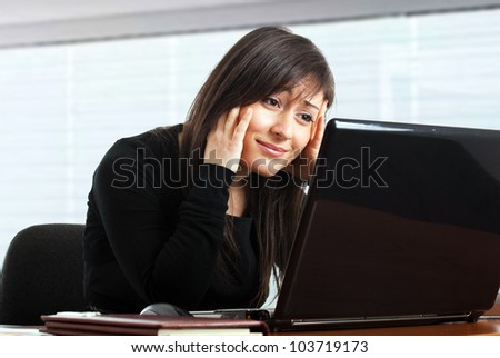 Businesswoman getting depressed in front of her laptop - stock photo