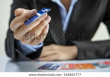 Businesswoman giving a credit card - stock photo