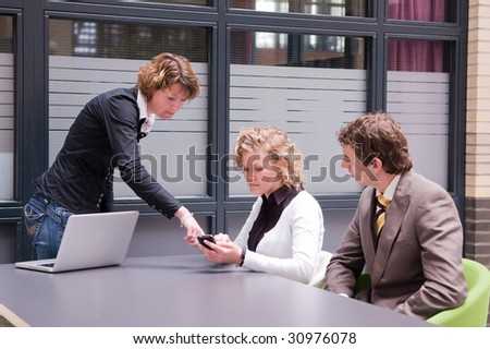 Businesswoman giving a workshop with her colleagues - stock photo