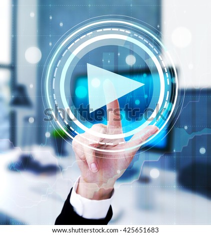 Businesswoman hand pressing abstract digital play button on blurry office background - stock photo