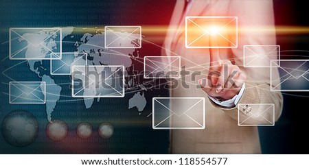 businesswoman hand pressing email letter on a touch screen interface - stock photo