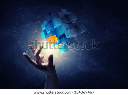 Businesswoman hand touch cube as symbol of problem solving  - stock photo