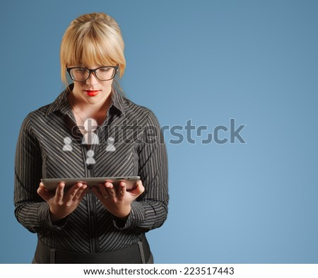 Businesswoman hands hold holding computer tablet with people social media icons - stock photo