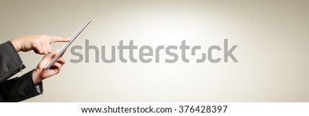Businesswoman hands holding a tablet touch computer gadget isolated. Free space for text.  - stock photo