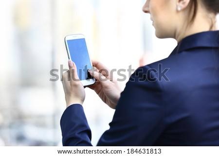 Businesswoman hands holding smartphone - stock photo