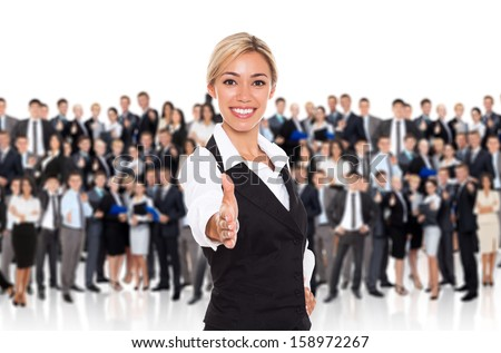 businesswoman handshake, human resource leader hire hold hand shake welcome gesture, young business woman happy smile over big group of businesspeople crowd background - stock photo