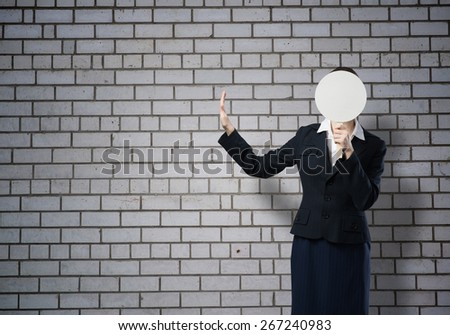 Businesswoman hiding her face behind round banner with smiley - stock photo