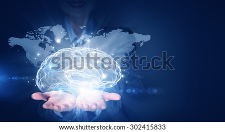 Businesswoman hold brain digital image on hand - stock photo