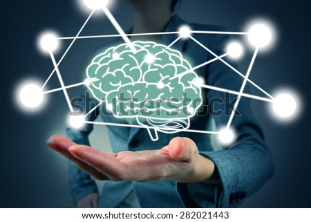 businesswoman hold brain symbol on hand - stock photo