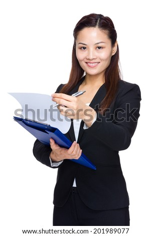 Businesswoman hold clipboard and look up paper document - stock photo