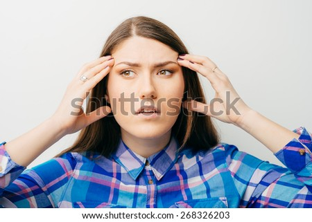 Businesswoman hold hands on temples head, young attractive business woman concept of business man stressed, headache, depressed, pain  - stock photo