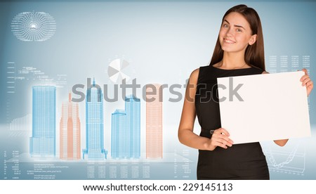 Businesswoman hold paper sheet. Wire-frame glowing buildings on transparent plane. Graphs as backdrop - stock photo