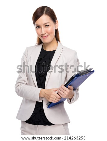 Businesswoman hold with clipboard and laptop computer - stock photo