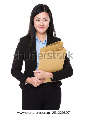 Businesswoman hold with folder - stock photo