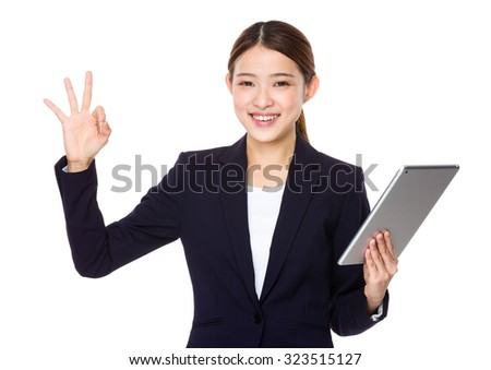 Businesswoman hold with tablet pc and ok sign gesture - stock photo