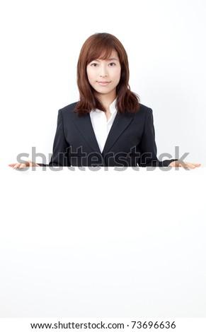 Businesswoman holding a blank presentation board - stock photo