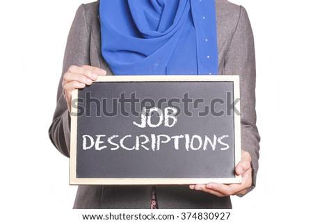Businesswoman holding a chalk board written Job Descriptions - stock photo