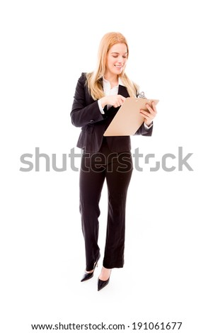 Businesswoman holding a clipboard - stock photo