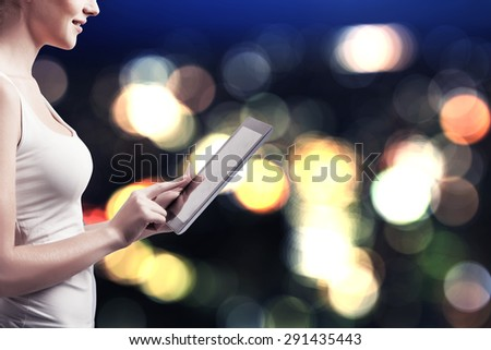 businesswoman holding a digital tablet - stock photo