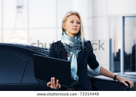 Businesswoman holding a laptop - stock photo
