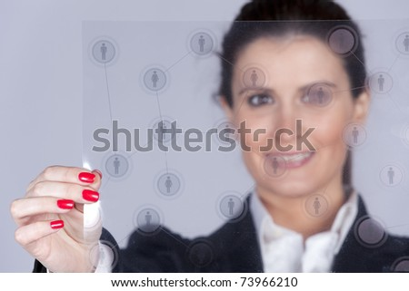Businesswoman holding a social network schema (selective and shallow DOF) - stock photo