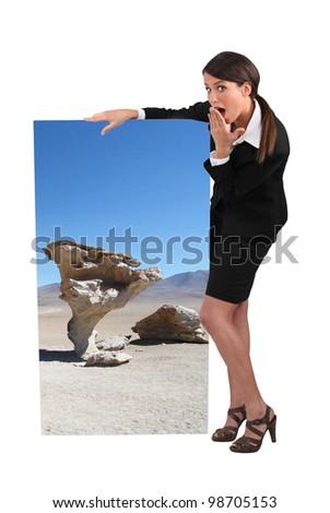 businesswoman holding a strange poster - stock photo