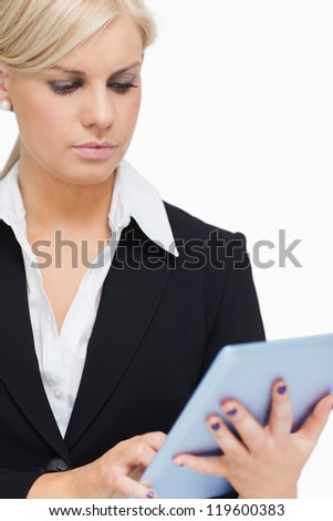Businesswoman holding a tactile tablet against white background - stock photo