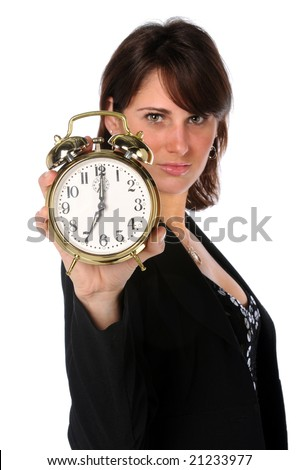 Businesswoman holding an alarm clock with selective focus - stock photo