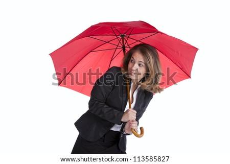 Businesswoman holding an umbrella - stock photo