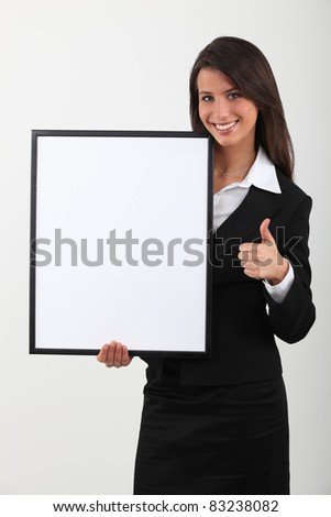 Businesswoman holding blank message board - stock photo