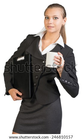 Businesswoman holding clipboard and mug, looking at camera. Isolated over white background - stock photo