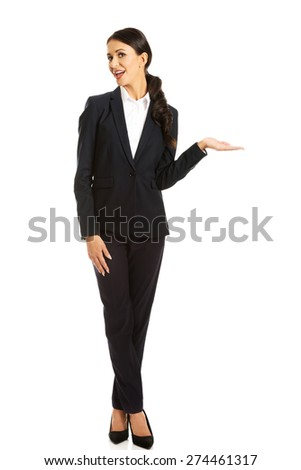 Businesswoman holding copyspace on the left hand. - stock photo