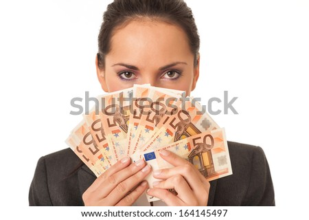 Businesswoman holding euro banknotes hiding herself on white background. - stock photo