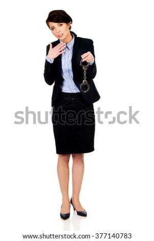 Businesswoman holding metal handcuffs. - stock photo