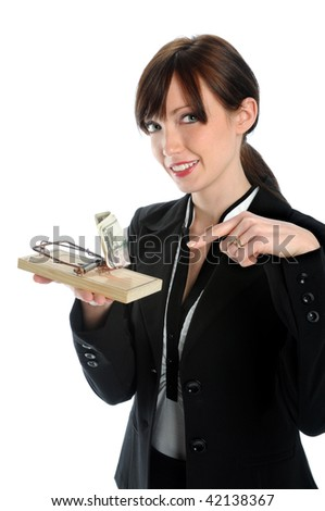 Businesswoman holding mouse trap with bait money - stock photo