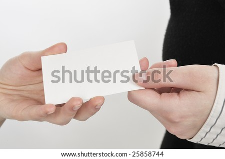 Businesswoman holding out a blank business card. Room for text, or your own message. - stock photo