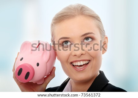 Businesswoman holding piggy bank. Isolated on white background - stock photo
