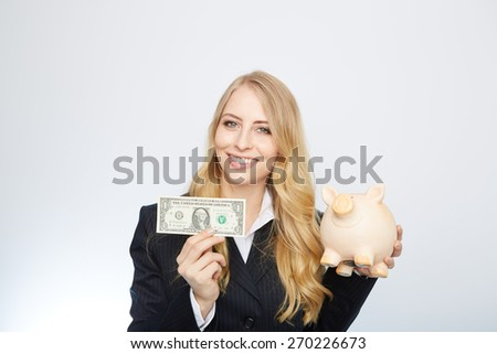 Businesswoman Holding Piggy Bank with an one dollar bill. - stock photo