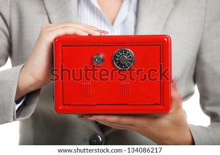 Businesswoman holding red safe in her hands. Close up - stock photo