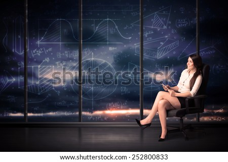 Businesswoman holding tablet in office room with graph charts on window concept - stock photo