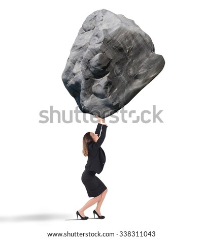 Businesswoman holding up a big rock heavy - stock photo