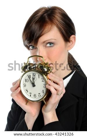 Businesswoman holding vintage alarm clock isolated over white background - stock photo