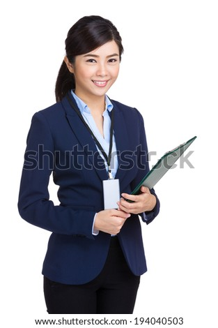 Businesswoman holding with clipboard - stock photo