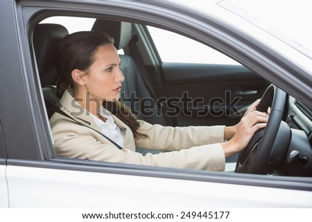 Businesswoman honking the horn in her car - stock photo